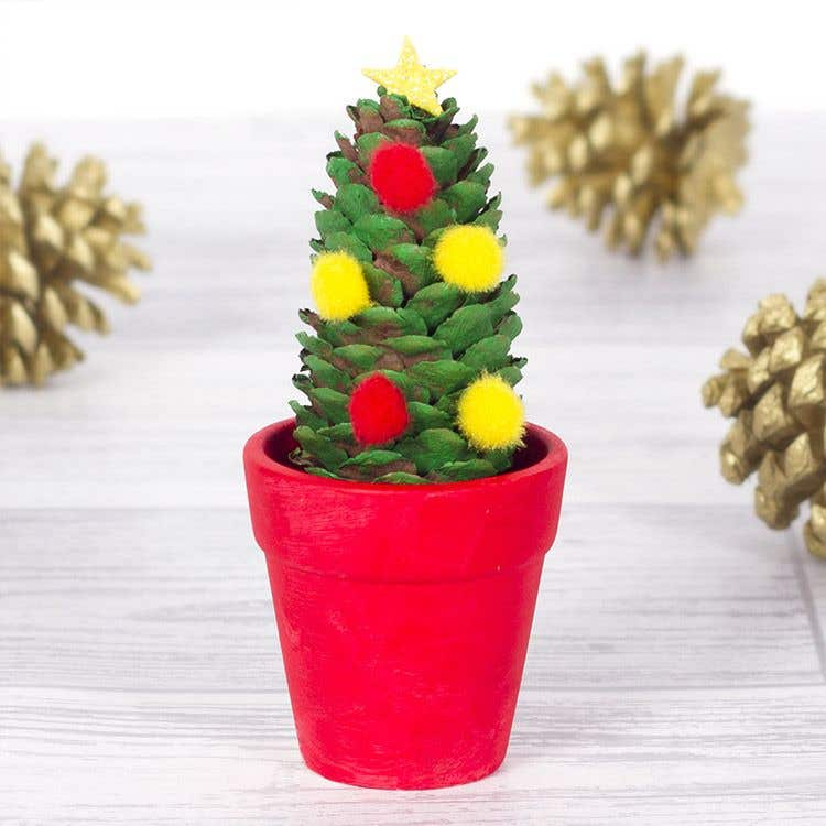 This cute little Christmas tree makes a great decoration for the Christmas table. & Mini Christmas Tree | Free Craft Ideas | Baker Ross